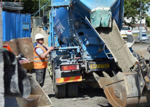 FP-McCann-Bradleys-Quarry-Lorry-supplying-Ready-Mix-Concrete-to-Ahoghill-social-housing-development-FEATURE